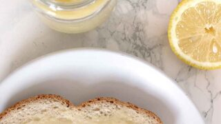 overhead shot of a jar of lemon curd and a piece of bread