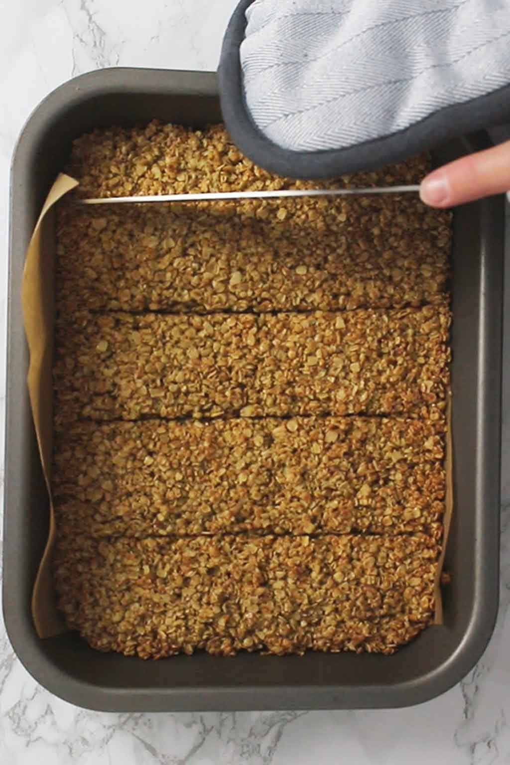 Scoring lines into baked vegan flapjacks