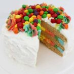 Vegan Rainbow Cake with a slice taken out of it
