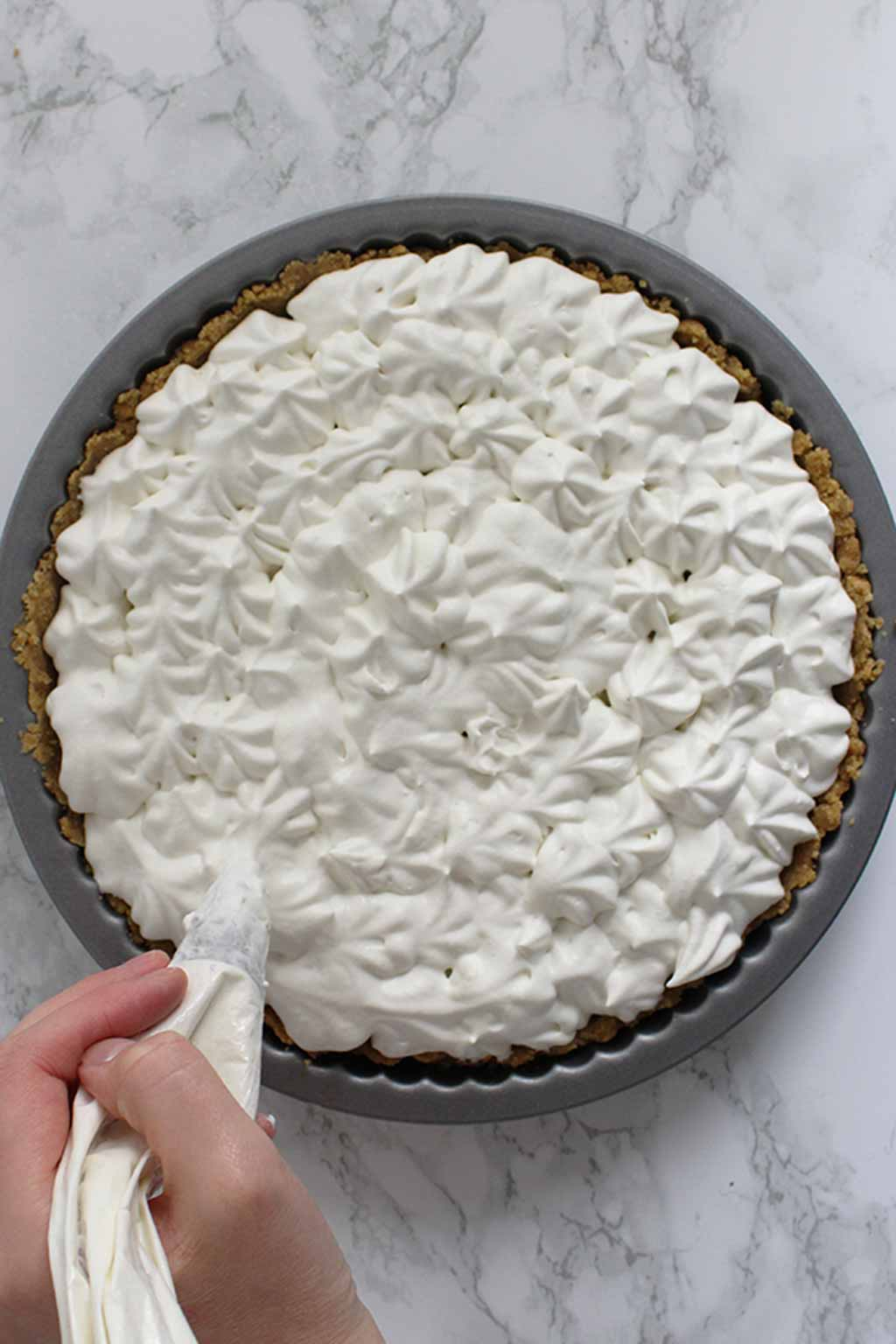 Piping Cream Onto The Pie