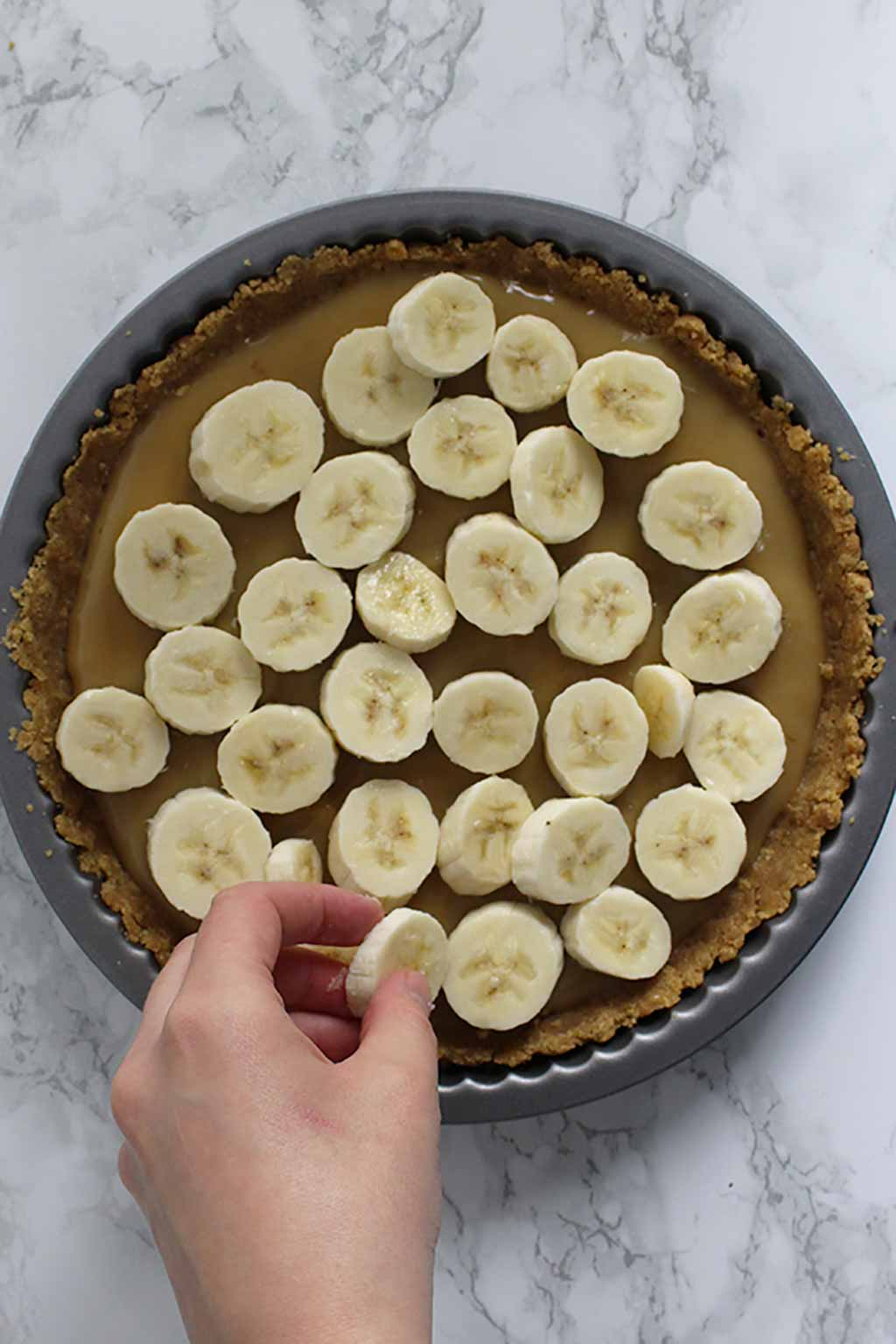 Placing Bananas On Top Of The Caramel