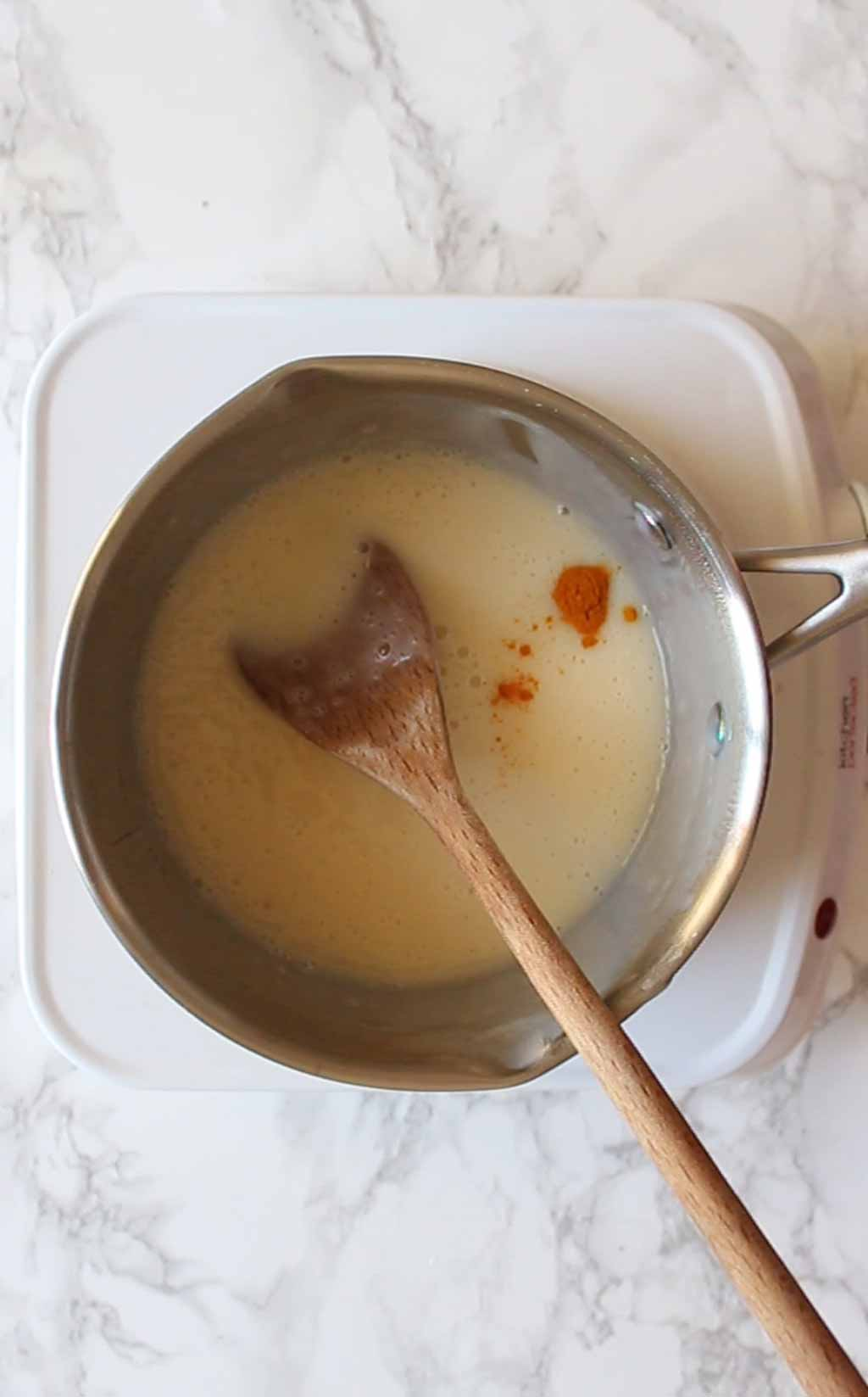 a pinch of turmeric added to the pot