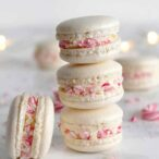 stack of 3 candy cane macarons with one side-facing macaron beside the stack