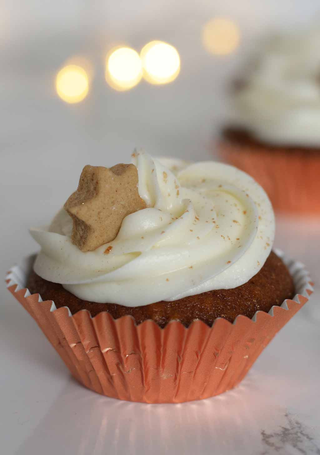 Gingerbread Cupcake In A Rose Gold Foil Case With Cream Cheese Icing And A Small Gingerbread Star On Top