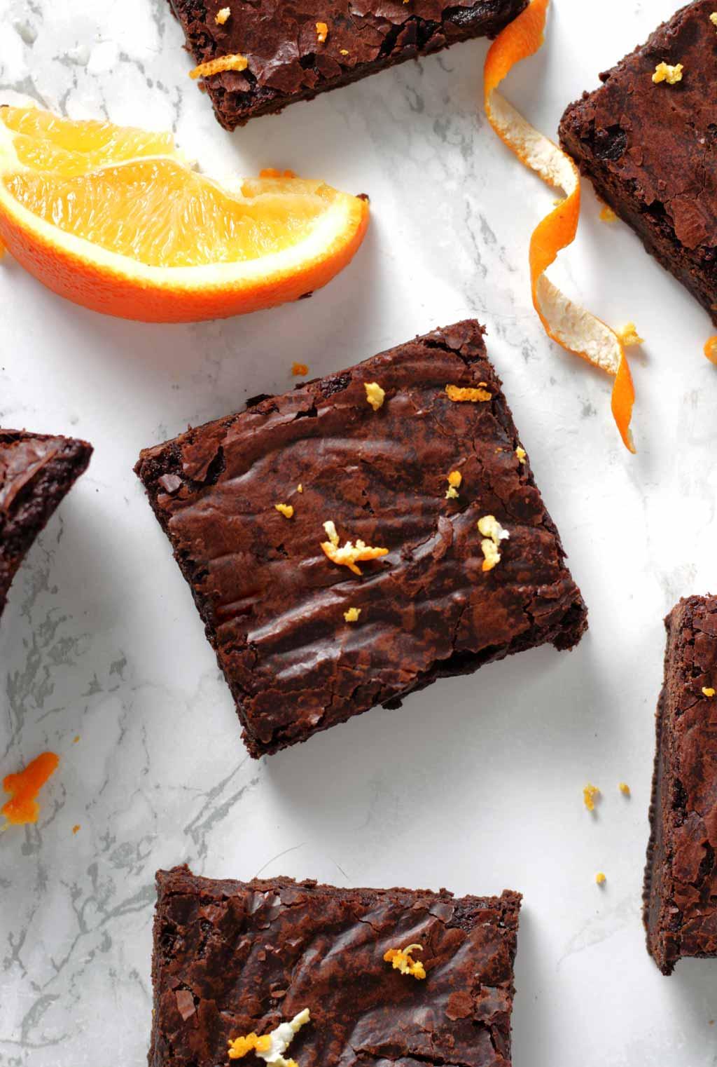Overhead Shot Of Vegan Chocolate Orange Brownies And A Wedge Of Orange