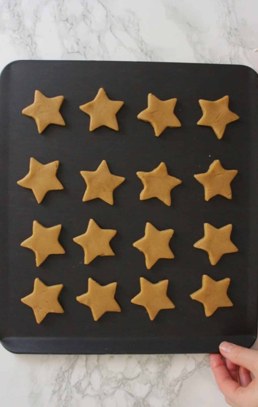 Star Cookies On A Baking Tray before going in the oven