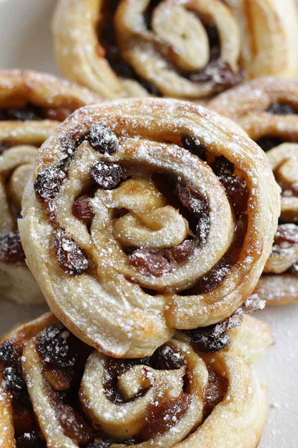 a close up of mincepie rolls on a plate