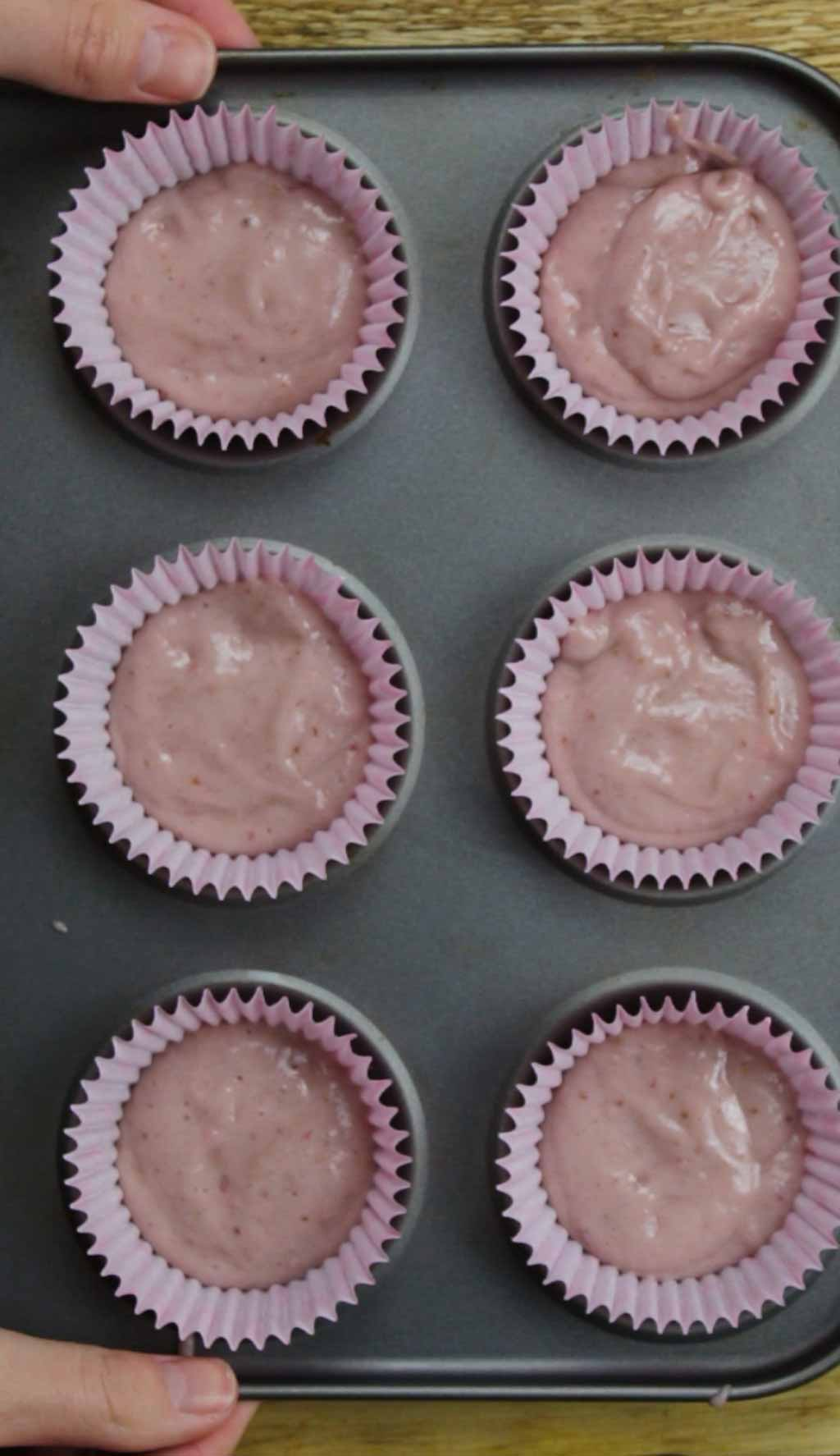 Cake Batter In Pink Cases In A Cupcake Tray