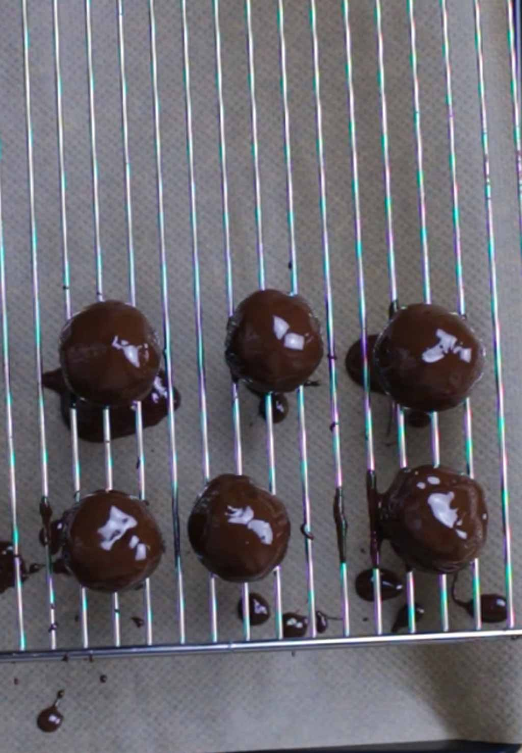 Chocolate Coated Truffles Resting On A Wire Rack