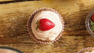 thumbnail image - overhead shot of cupcakes with fresh strawberries on top