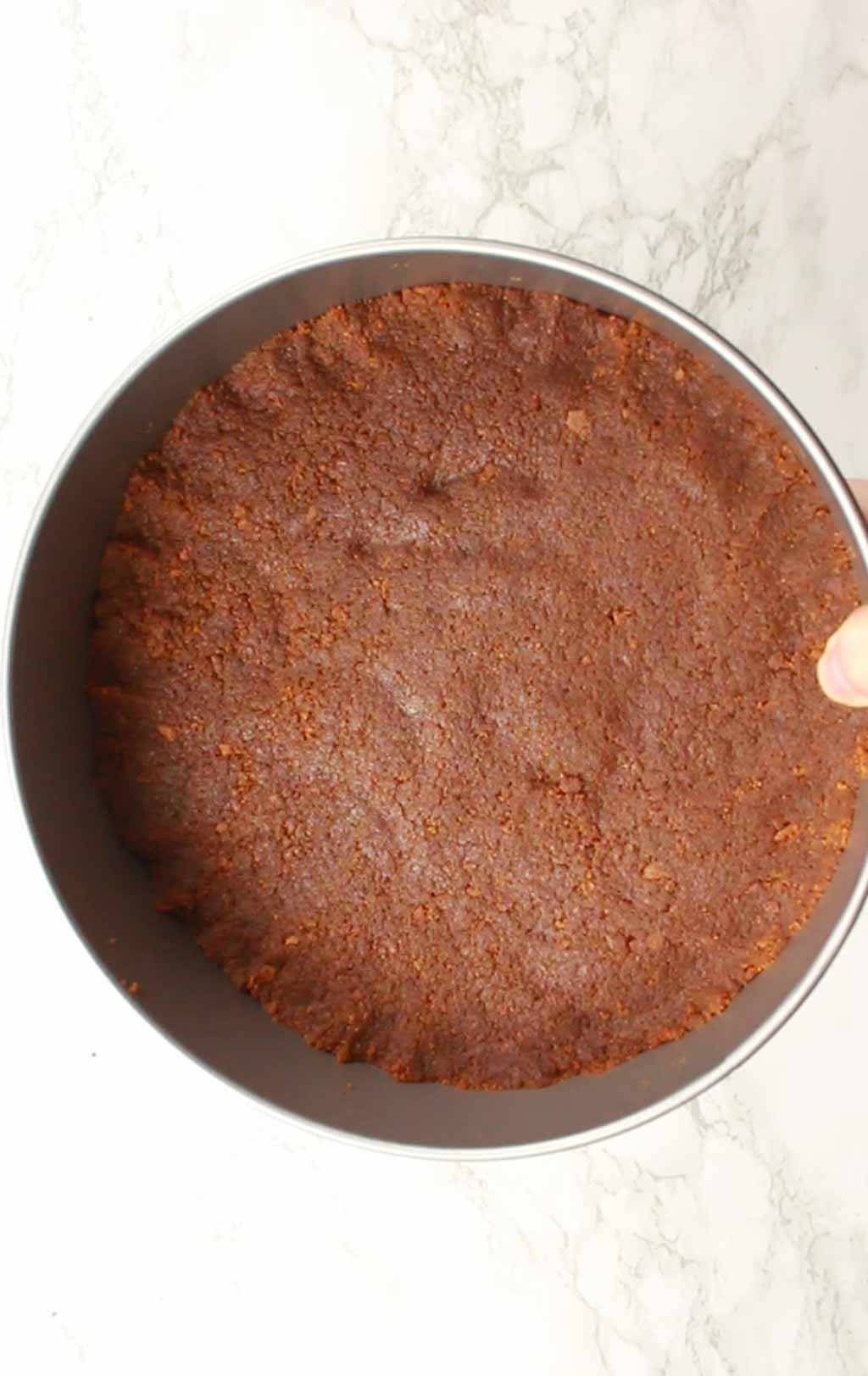 Cheesecake Base Flattened Into Tin