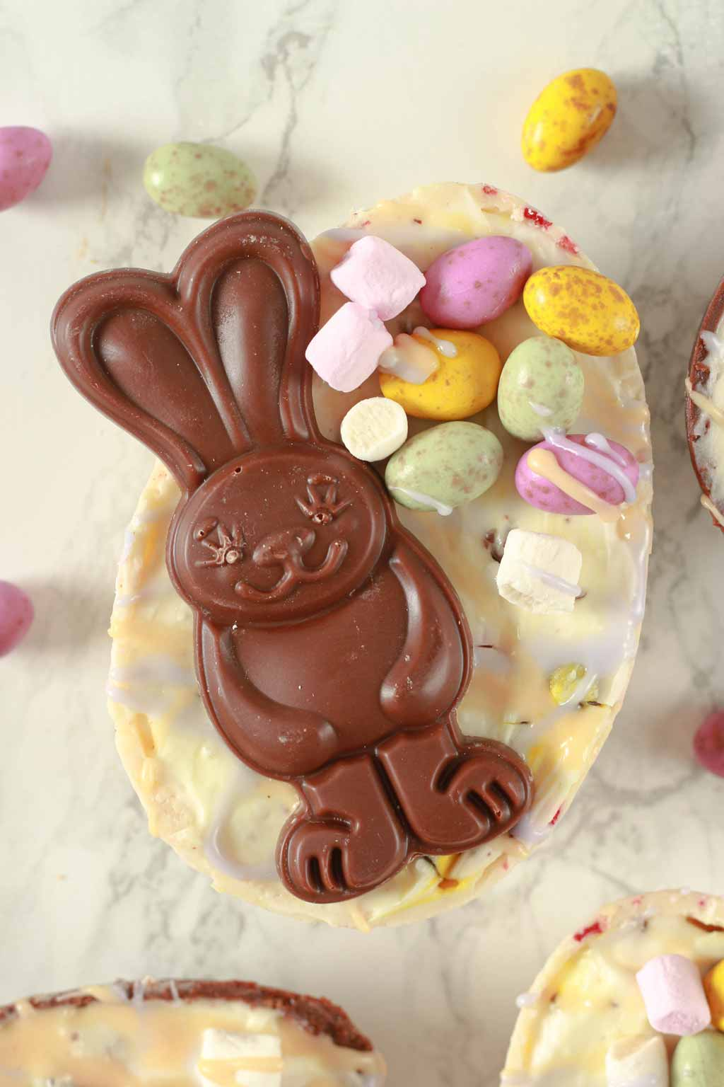 Cheesecake Filled White Easter Egg Topped With A Vegan Chocolate Bunny And Mini Eggs