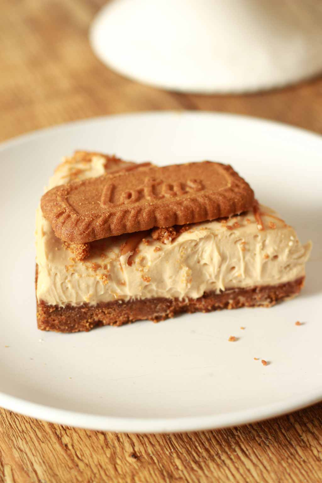 Slice Of Vegan Cheesecake With A Biscoff Biscuit On Top