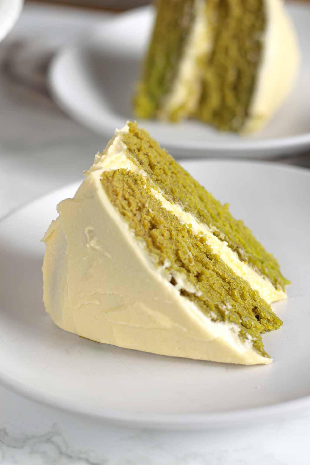 Slices Of Matcha Cake On White Plates