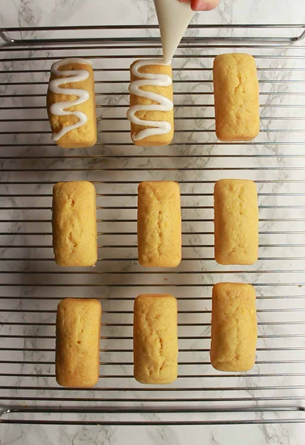 Piping Icing Onto The Baked Mini Loaves