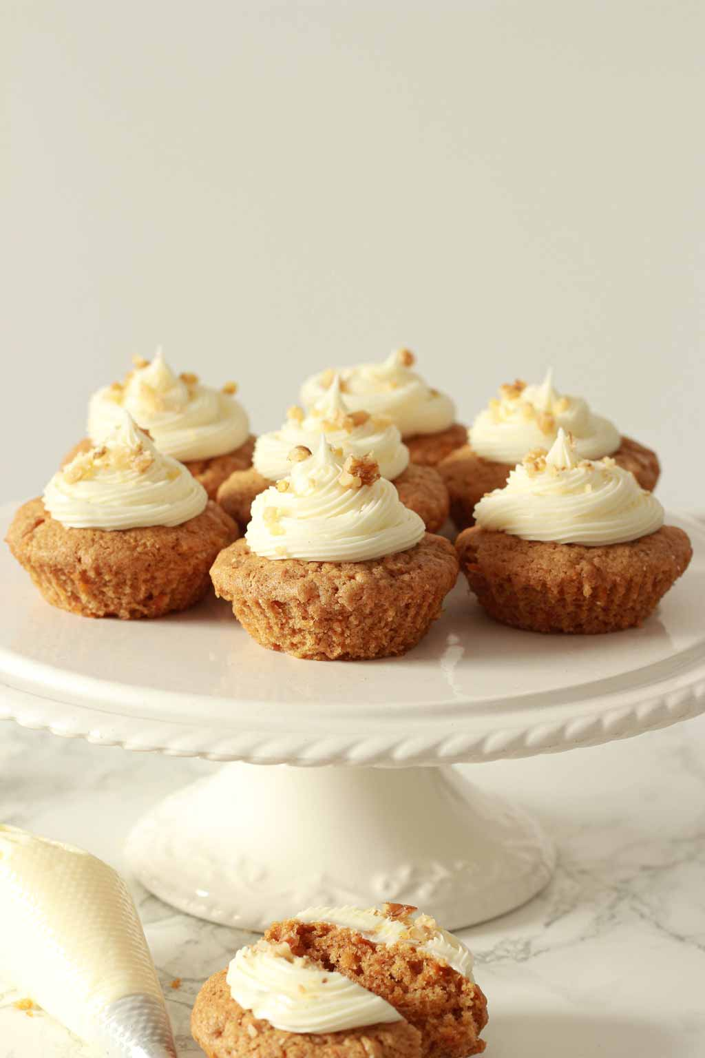 Vegan Carrot Cupcakes On A White Cake Stand
