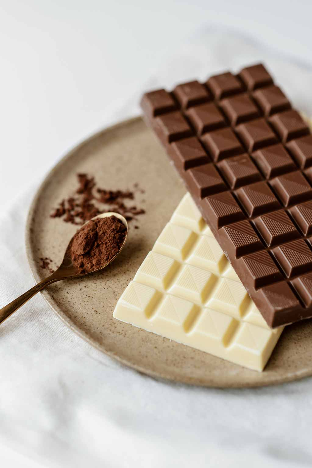 a dark chocolate bar on top of a white chocolate bar