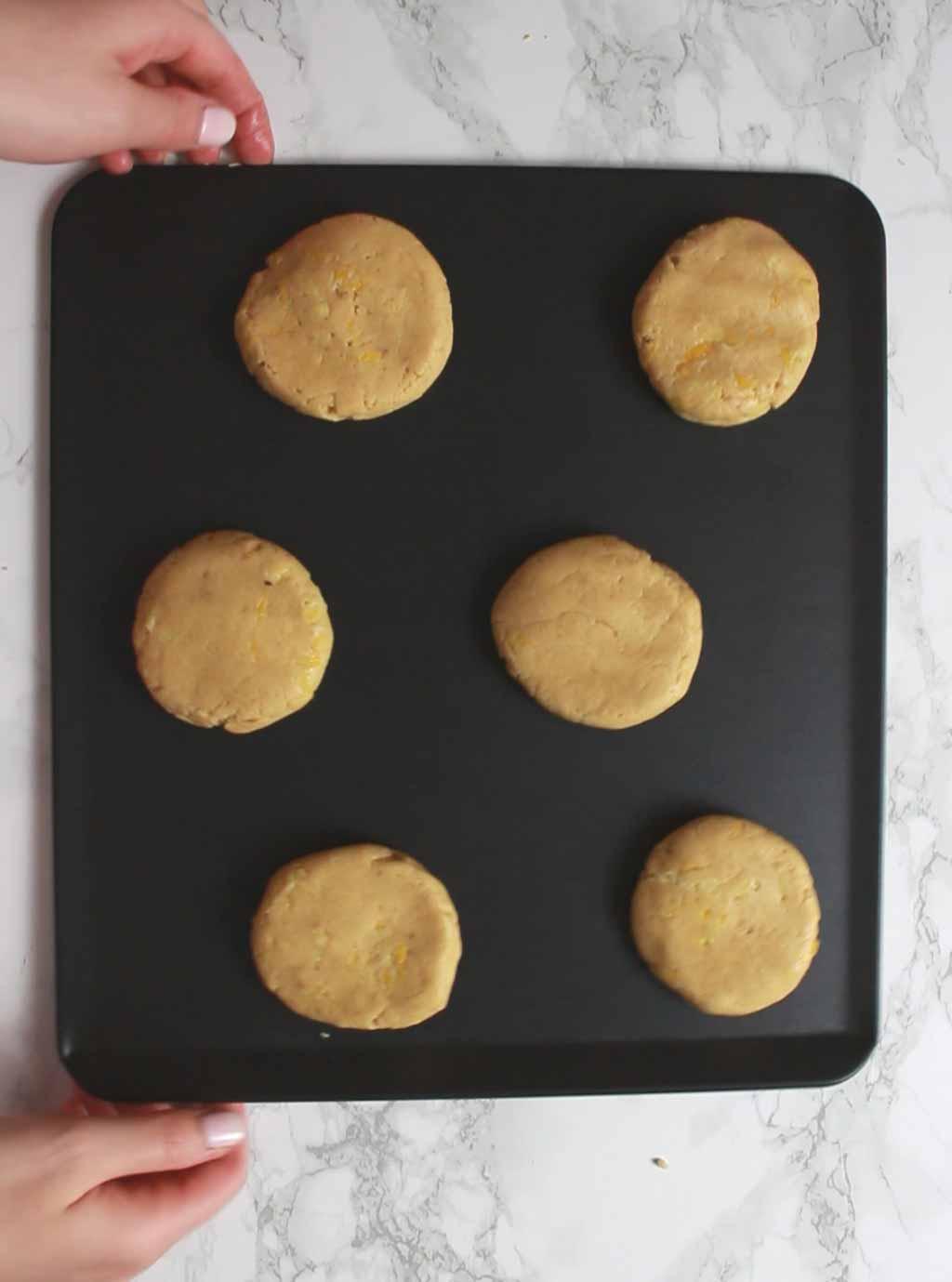 lemon Cookie Dough Discs On Tray Before Baking