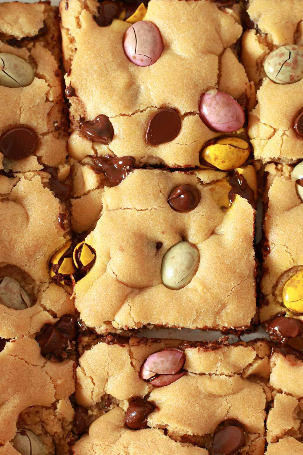Overhead Shot Of Cookie Squares With Mini Eggs And Chocolate Chips In Them