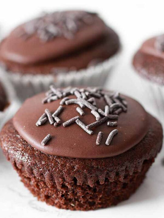 thumbnail image of chocolate fairy cake with sprinkles on top