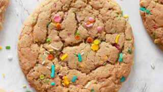 Thumbnail image of vegan funfetti cookies laying on a white background