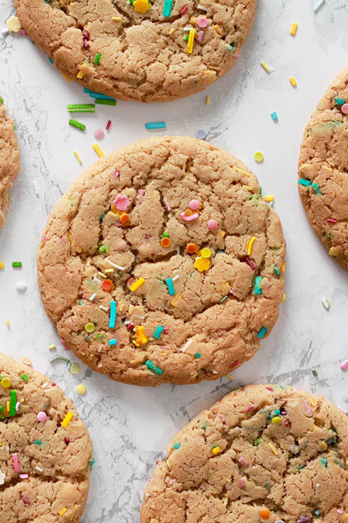 Vegan Funfetti Cookies Laying Flat On A White Background