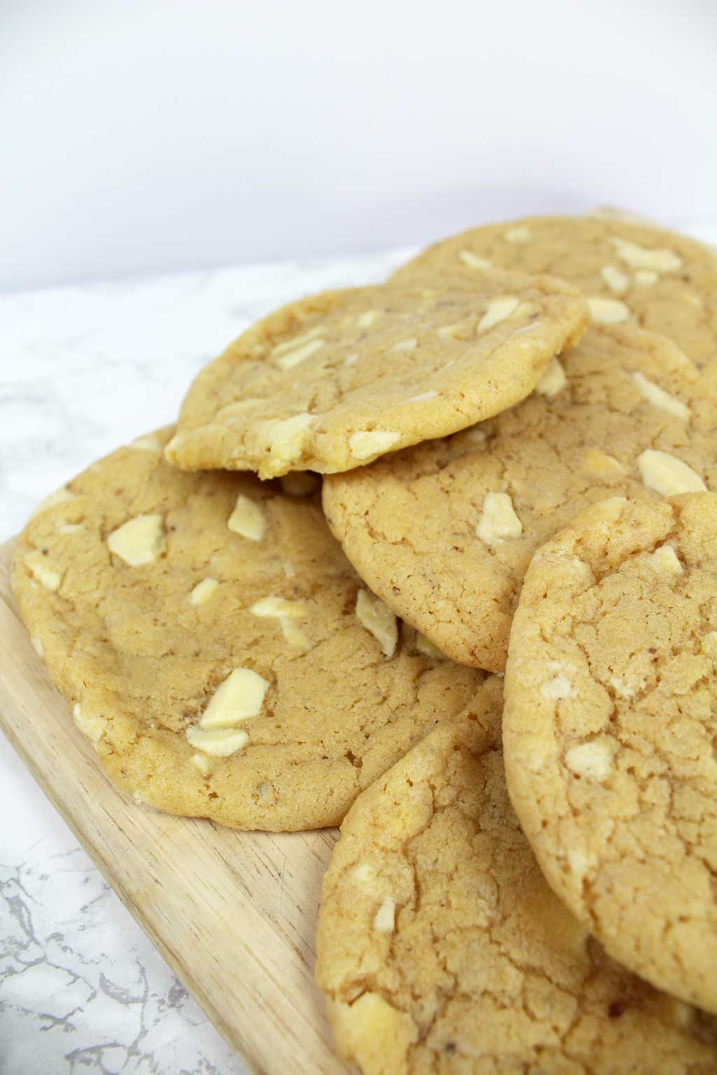 Vegan White Chocolate Cookies in a pile