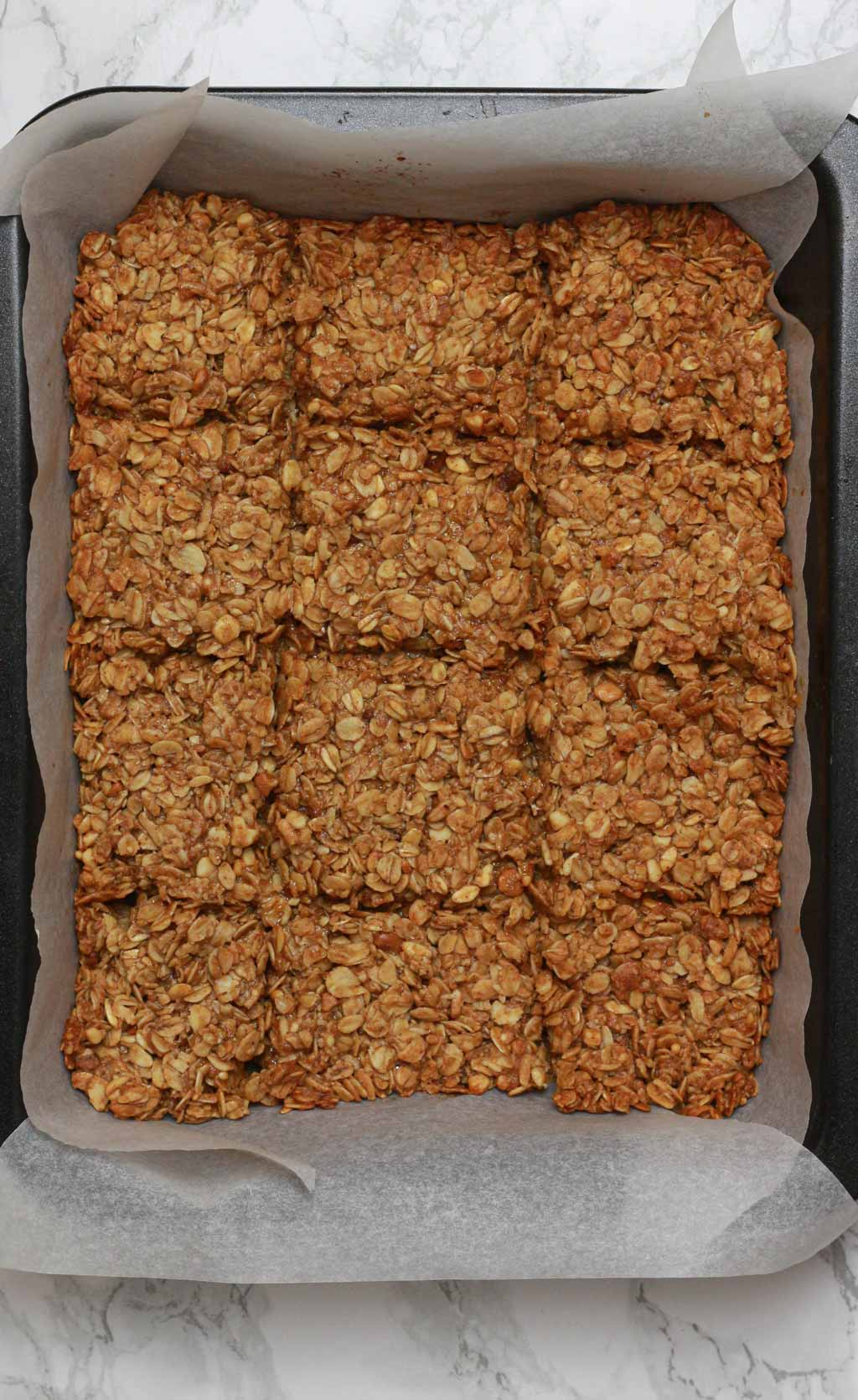 Baked Flapjacks With Score Lines In Them While Still In The Tin