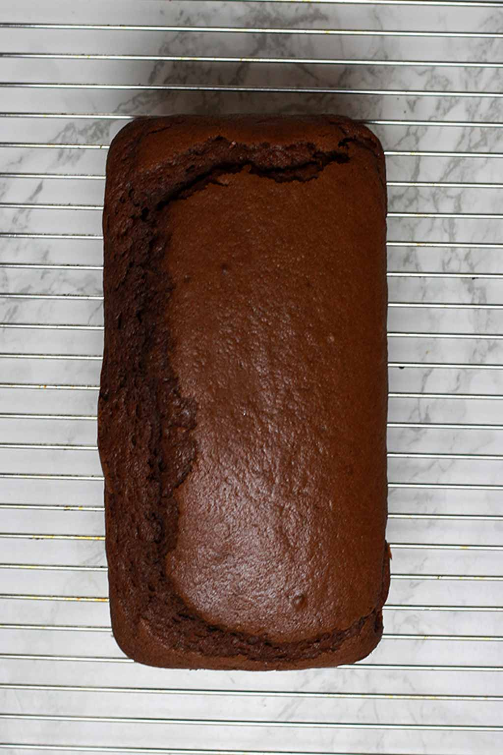 Chocolate Loaf Cooling On A Wire Rack