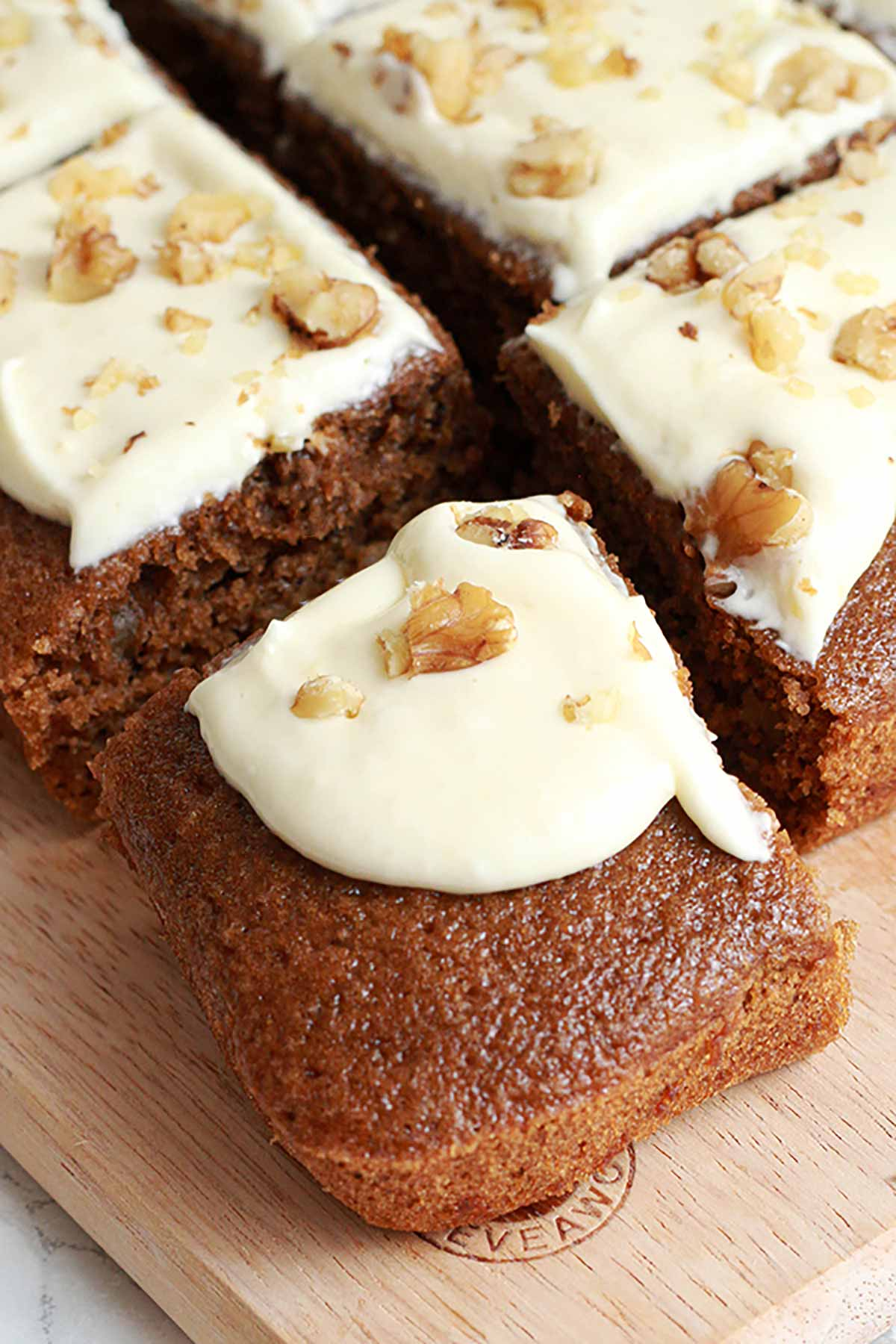 Coffee Cake With Cream Cheese Frosting And Walnuts On Top