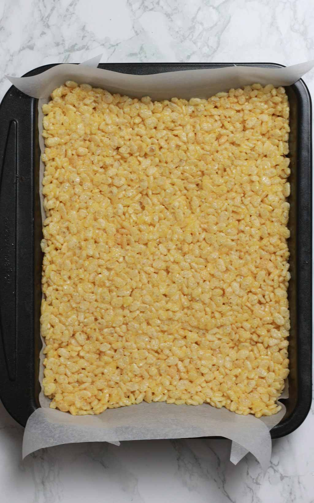 Rice Krispie Mixture Pressed Into A Lined Tin