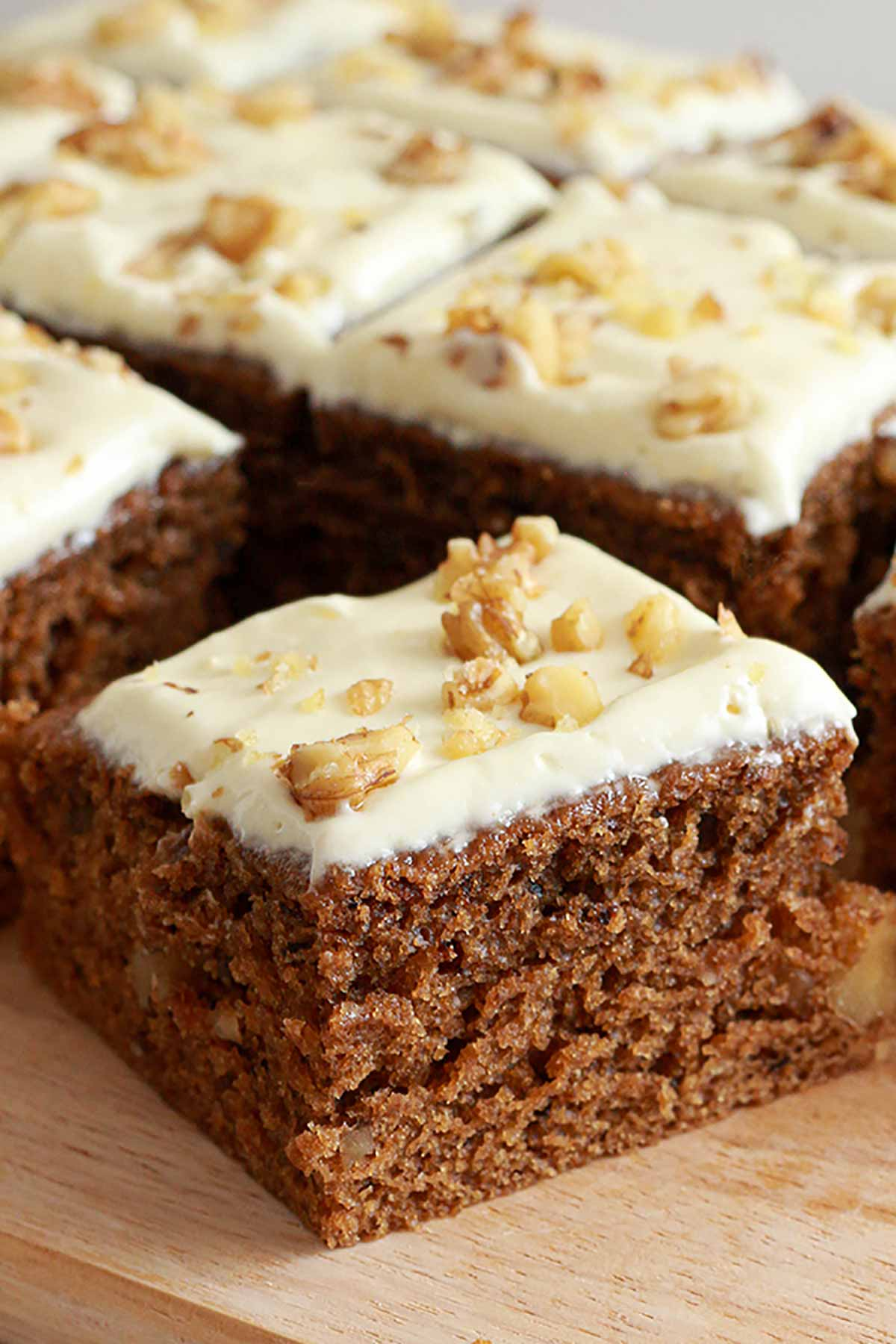 Slices Of Coffee And Walnut Cake On A Wooden Board