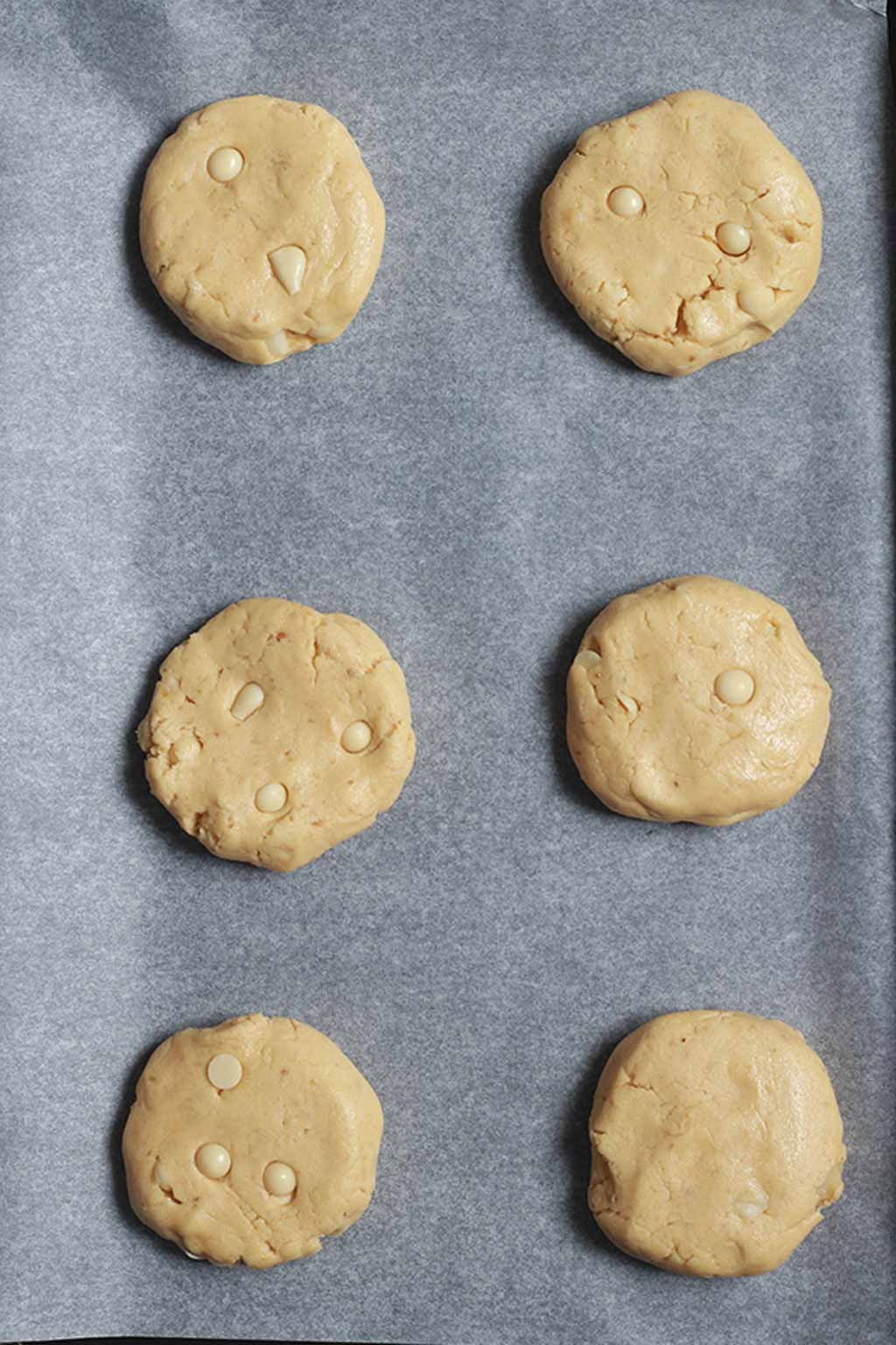 Discs Of Cookie Dough On A Baking Tray