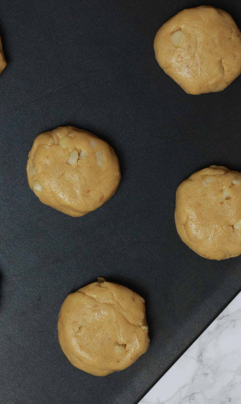 Discs Of Cookie Dough On Baking Tray