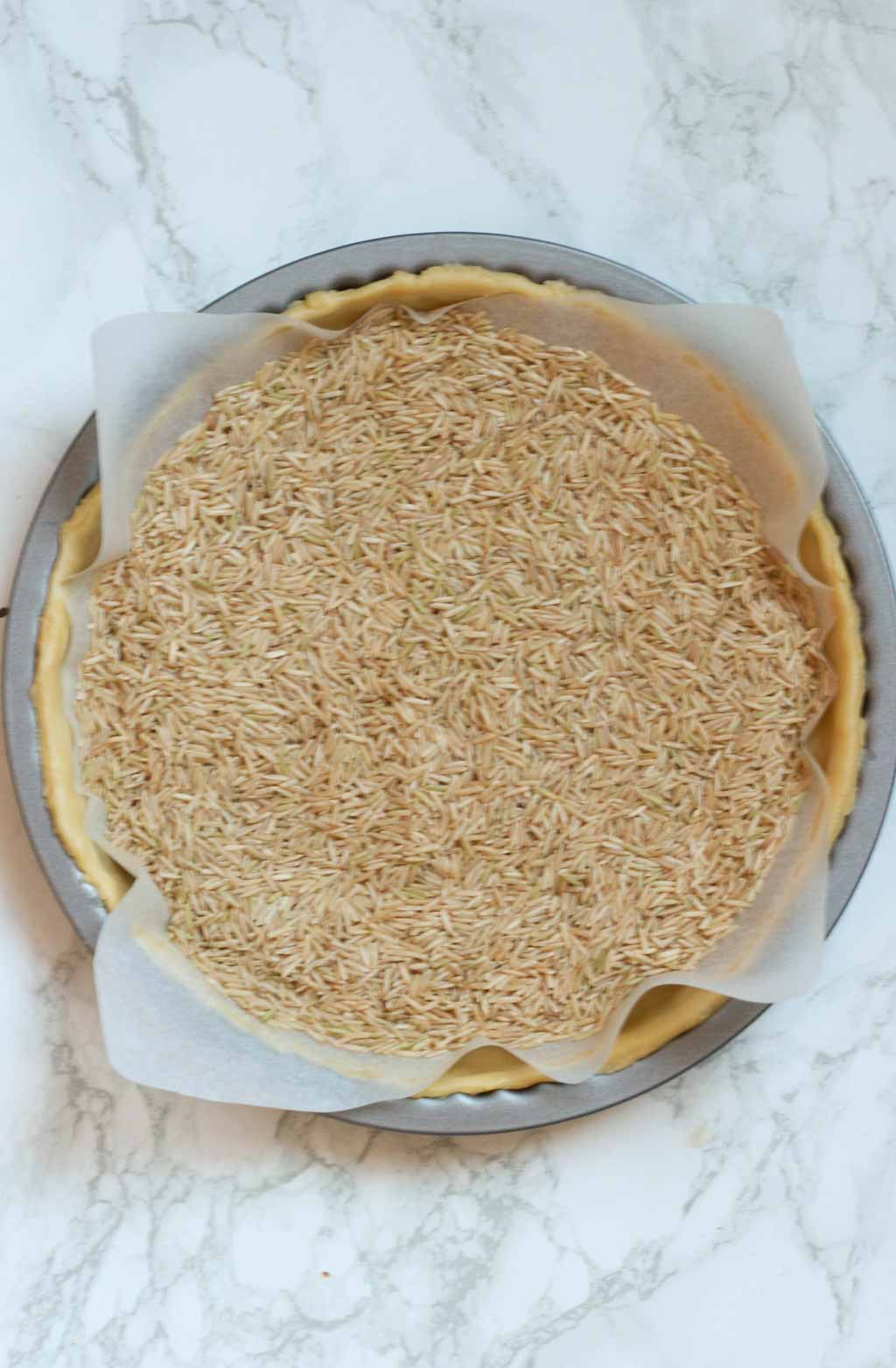 Dough In Tin With Baking Paper And Rice On Top