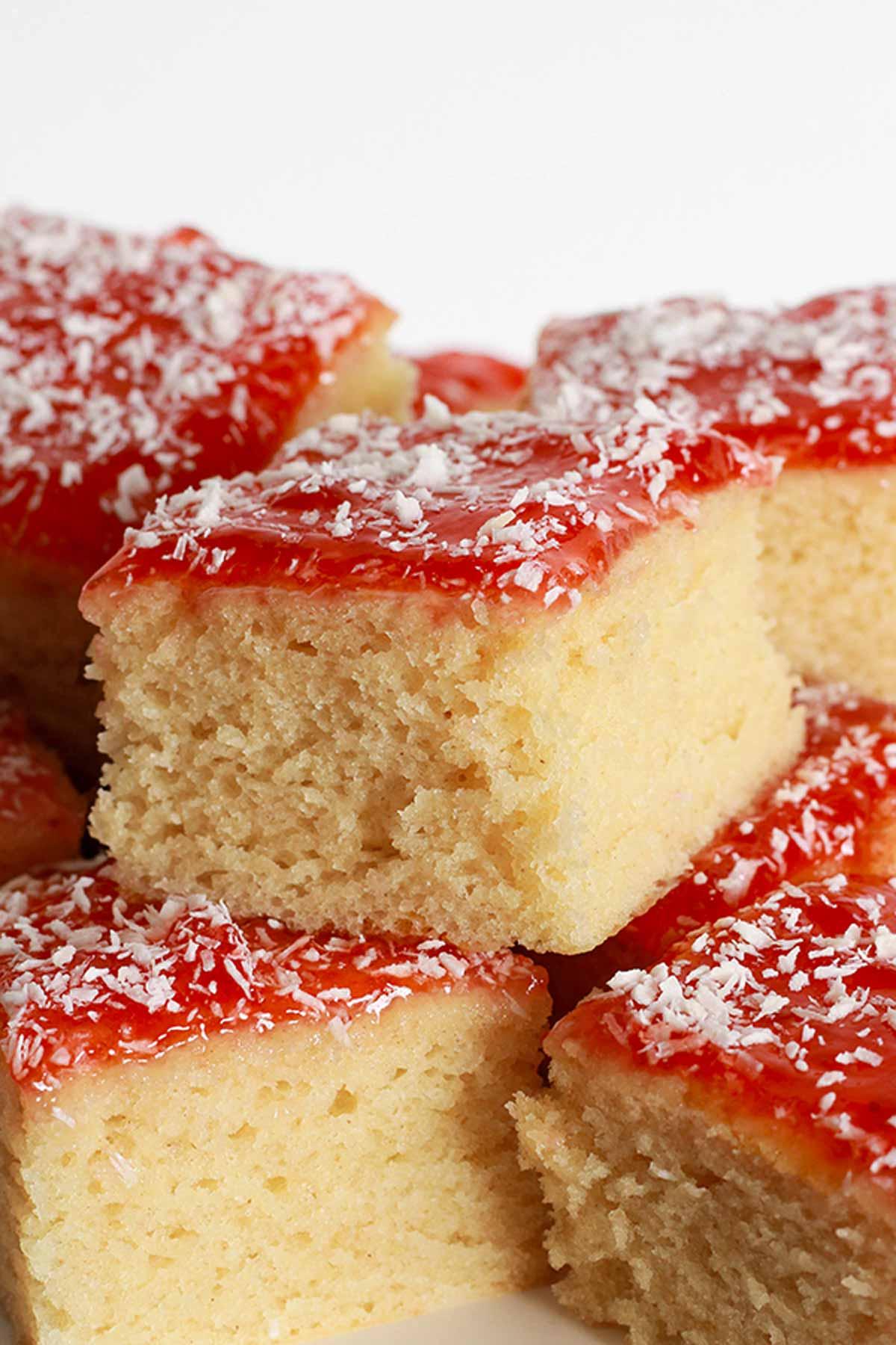 Square Slices Of Vegan Jam And Coconut Sponge