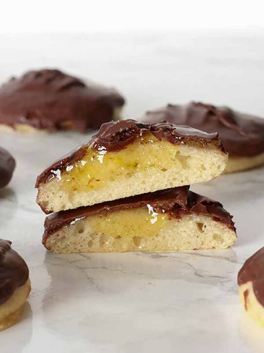 Thumbnail Of 2 Jaffa Cakes Cut Open Showing The Orange Centre