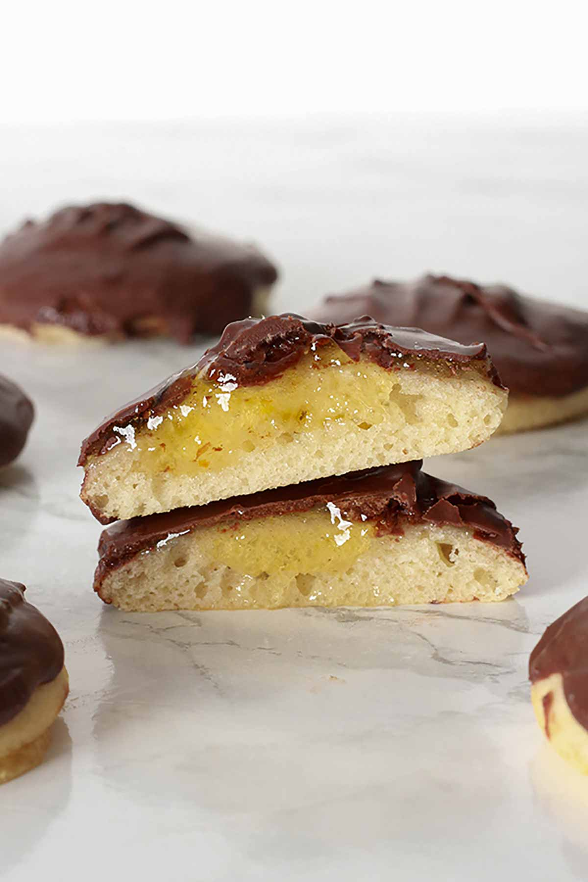 Two Jaffa Cakes Stacked On Top Of One Another