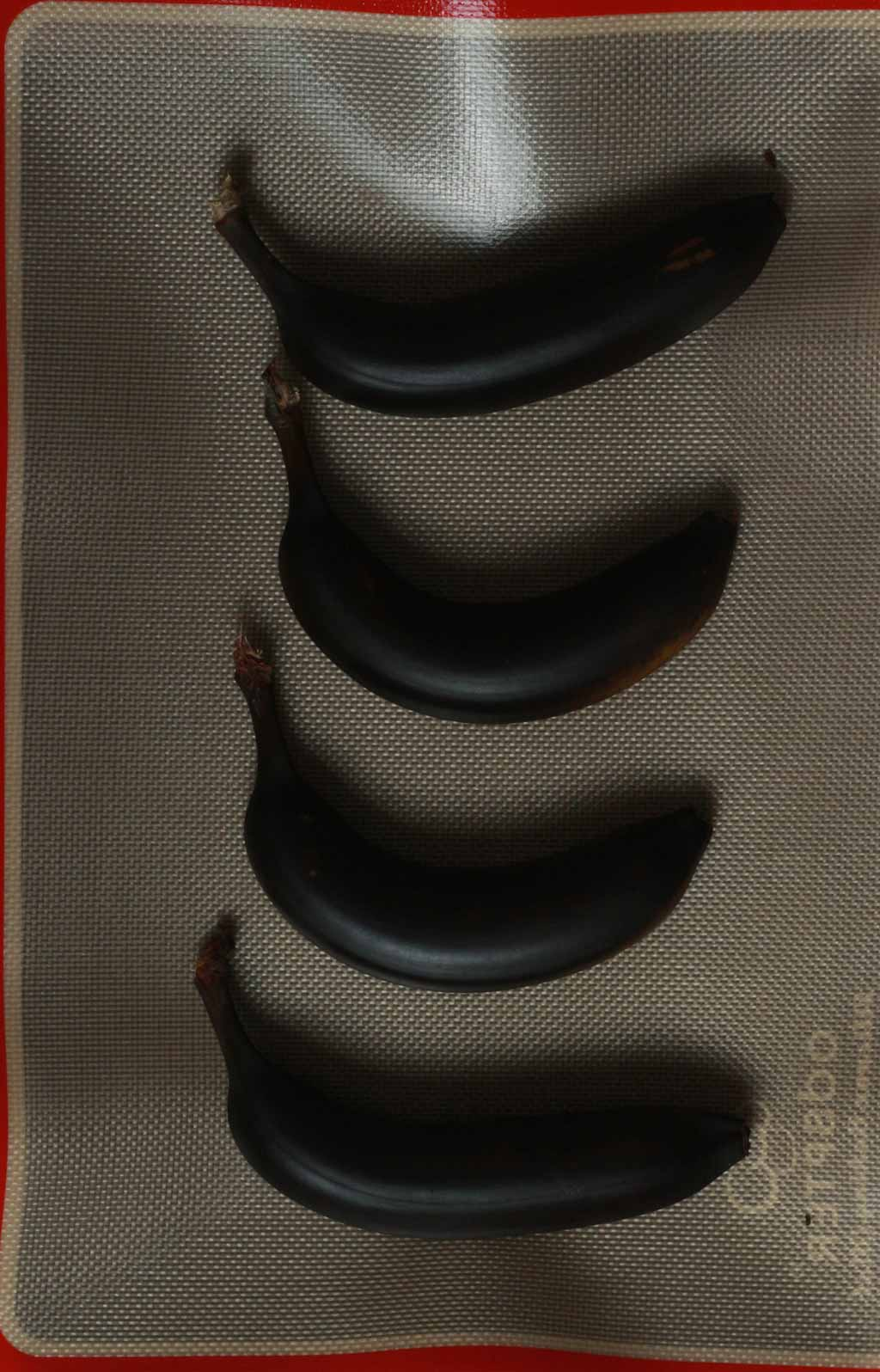 Black Baked Bananas On A Silicone Sheet