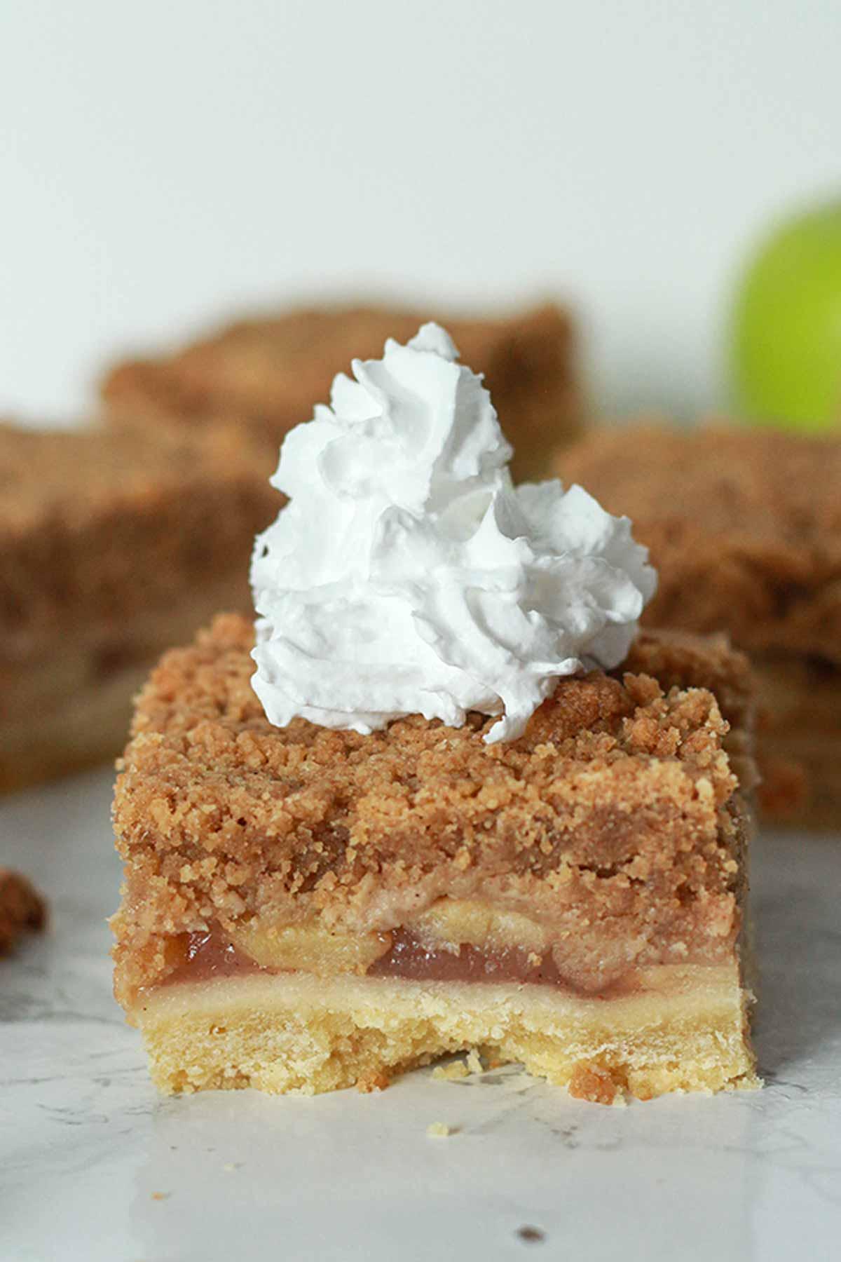 Vegan Apple Crumble Bar With Cream On Top
